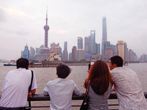 Taking in the view of the Bund