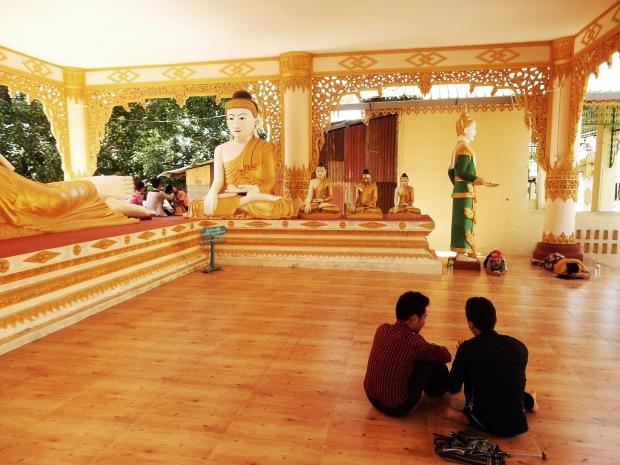Napping, chatting and socialising at the Shwesandaw pagoda, Twante